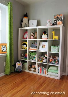16 cubbies. IKEA. Couldn't do without this in our playroom. Bins, too. Note: photos inside a few cubes