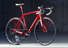 "ELITE RED ROAD BIKE - Frame:Specialized FACT 8r carbon, FACT IS construction, compact race design, 1-1/2"" lower bearing,  OSBBFork:Specialized FACT carbon, full monocoque, OS"