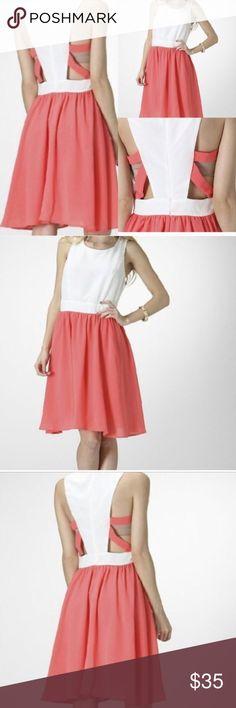 White & Salmon Cut Out Back Dress Gorgeous white and salmon dress. Cut out detail in back. Fit and flare style. Boutique Dresses