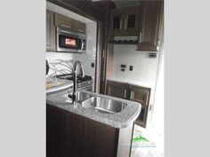 2016 New Keystone Rv Fuzion 414 Chrome Toy Hauler in Virginia VA.Recreational Vehicle, rv, 2016 Keystone RV Fuzion 414 Chrome, A weekend fort and relaxation....loads of fun!  With this Keystone Fuzion 414 Chrome fifth wheel toy hauler you will get it all!  This model features one and a half baths, sleeping for 9 or 10, a loft, a king bed in the master, triple slides for plenty of space, plus 12' of garage area for your toys and you to hang out!Check it out!  Loading things will be easy…
