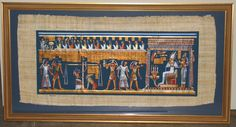 An Egyptian papyrus painting mounted and framed by Custom Framing to you