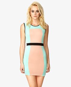 A scuba knit bodycon dress featuring a colorblocked pattern with contrast trim. Round neckline. Sleeveless. Banded waist. Knit. Lightweight.