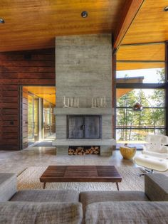 Who wouldn't want to gather round this rustic contemporary fireplace?  Check out 16 more designs >> www.hgtvremodels.com/interiors/17-hot-fireplace-designs/pictures/index.html?soc=hpp #hgtvholidays