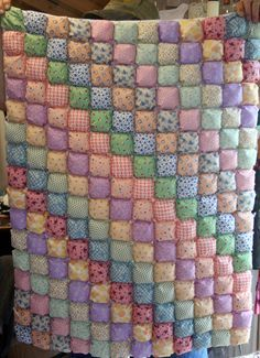 """According to the lady who made this, it's called a """"Biscuit Quilt""""  I love the pattern, but it looks a little too ambitious for me."""