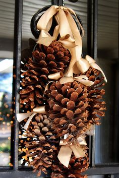Although my life and home will never be this picture-perfect, this holiday home tour has lots of cute and easy ideas, like this swag of pine cones for the front door, and a cute saddle of pine cones, ribbon, and boughs for the mailbox.