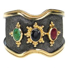 Damaskos Triple Stone Black Gold Vamp Band Ring, 18k Gold, a Sapphire, Ruby and an Emerald. Athena's Treasures: http://www.athenas-treasures.com/