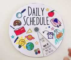 Staying at home during school closures and becoming full-time homeschoolers is new for us. Having a daily routine really helps the day go by smoothly. And because schedules can be boring, I made this spinning daily schedule dial for my daughter. It's an interactive way to organize your child's day. You can download the template as a FREE PRINTABLE and make your own. #freeprintables #diy #craftsforkids #diykids #homeschool #thesciencewomen #homeeducation #familytime #parenting #parentinghacks