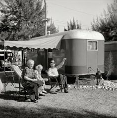 """1941. """"Guests at Sarasota, Florida, trailer park."""" Mr. and Mrs. L. Lulof of Grand Haven, Michigan. Photo by Marion Post Wolcott."""
