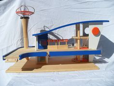 Space Age Wood Airport Playset Modern Solid Wood Toy The Jetsons Fly Here. $65.00, via Etsy.