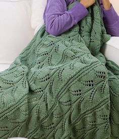 Free Knitting Pattern for Hawaiian Lacy Fern Throw - Lace afghan worked in 3 panels that are seamed together. 52″ x 64″ (132cm x 162.5cm). Designed by Joyce Nordstrom for Red Heart.