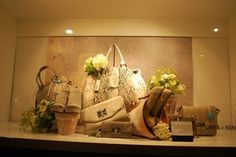 Accessory display - create a garden with flower pots, watering cans, and fresh flowers to display accessories