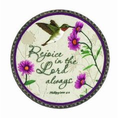 """Garden Stepping Stone Hummingbird Rejoice In The Lord by Russ Berrie. $24.99. This pretty ceramic stepping stone is decorated with a hummingbird and says """"Rejoice In The Lord Always""""."""