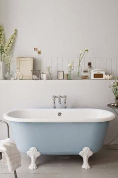 Such a pretty roll top bath - love the colour and bringing nature into the home. Bathroom style and interior inspiration