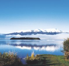 Lake Taupo with snowclad Mt Ruapehu in the distance, reflected in the lake. . .North Island, NZ. - several campgrounds around the lake, a large variety of accommodation in the Taupo area, snow sports up Mt Ruapehu.