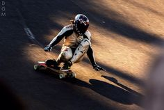 Pro Downhill Longboarder Kevin Reimer races to the finish line like a boss.    From http://northwestrider.tumblr.com/