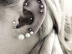 #piercing ; 3 lobe, tragus, anti-tragus, conch, rook, 3 helix. #piercings