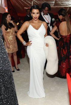 #kimkardashian wears a #donnakaran resort gown at Elton John's party. #oscars