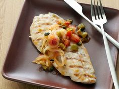 Grilled Snapper Vera Cruz : Need an escape? Transport yourself south of the border with this Mexican-inspired fish dish. Serrano chiles add a spicy kick while tomatoes, olives and capers add a light salty flavor.