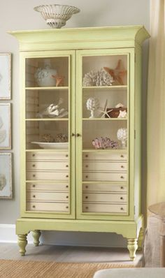 beautiful cabinet / lovely green color / pale gray walls