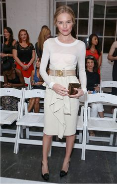 Kate front row at Altuzarra in her JewelMint Gold Envelope Case. Perfection.  Image via Zimbio.