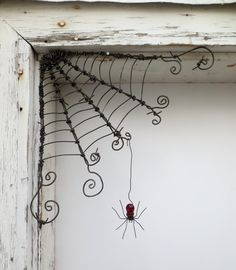 """Czechoslovakian Red Spider Dangles From 12""""  Barbed Wire Corner Spider Web. $51.00, via Etsy. - need to make my own.."""