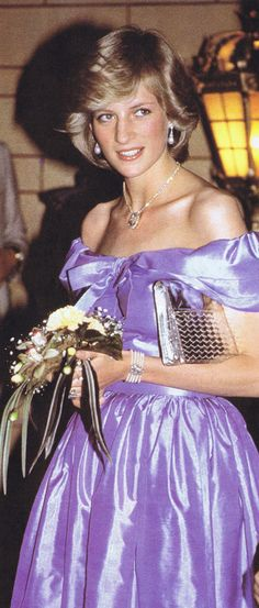 Princess Diana wearing a Donald Campbell gown and Prince of Wales feathers necklace, attends the ballet 'Copella' on April 18, 1983 in Aukland, New Zealand.