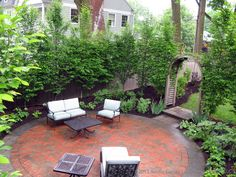 Circular bluestone and Brick patio, surrounded by european hornbeam hedge, and perennial shade gardens, Southport, CT.
