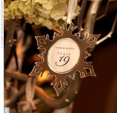 Think winter wedding: Christmas ornaments hanging from a tree can act as favors and escort cards. So clever