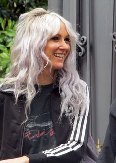 If you don't like 1D you probably don't know that this, Lou Tesdale,  is the coolest hairdresser, stylist and mum. She's just amazing and I love her style and she's just perfect.