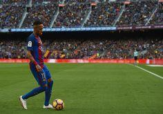 Neymar JR of Barcelona walks on the pitch during the La Liga match between FC Barcelona and Malaga CF at Camp Nou stadium on November 19, 2016 in Barcelona, Catalonia.