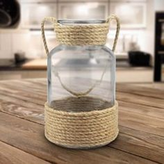 This Wrapped Rope Vase is the perfect neutral accent to your coastal decor. Its rope base adds the texture your tabletop or mantel is missing. Dollar Tree Vases, Dollar Tree Crafts, Dollar Tree Centerpieces, Tree Rope, Diy Candle Holders, Diy Candles, Rope Crafts, Jar Crafts, Glass Candle