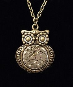 Steampunk Clockwork Owl pendant with vintage ruby watch movement and gears