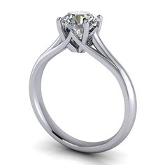 Beautifully crafted to perfection. A solitaire engagement ring is simple, chic and timeless. Ring Name: Giselle Center Stone Trade Name: Moissanite Size: 6.5 mm Forever Brilliant Round Color: Near Col