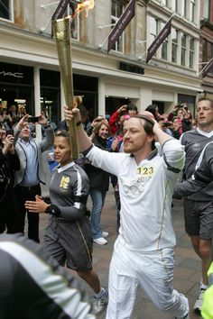 James McAvoy of X-Men: First Class & Atonement carries the Olympic Torch through Glasglow, Scotland. #ETCanada Photo: Courtesy of Glasgow City Marketing Bureau