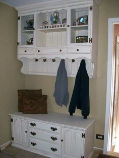 Take that bulky old dresser and divide it up in the mudroom....half bench and half hanging coat rack!