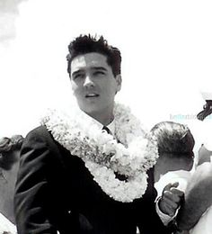 Elvis arrives in Honolulu, Hawaii for his 1961 benefit concert for the building of the USS Arizona Memorial, March 25, 1961