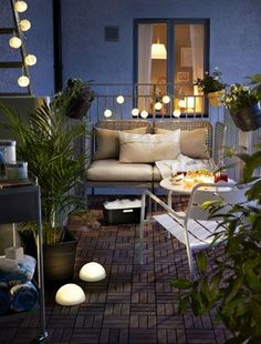 Wood decking that looks like parquet flooring is a perfect indoor/outdoor solution for a small patio. Decking by Ikea.