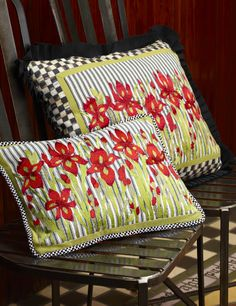 Beautiful embroidered pillows inspired by our very own gardens in Aurora.