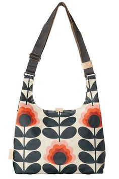 """Classic Orla Kiely matt laminated midi sling bag in the 'Summer Flower' print with leather trims double sided adjustable webbing strap and leather magnetic tab for closure. Inside details include sand Linear Stem jacquard lining small leather logo card holder pocket small zip pocket elasticated key chain and mobile pocket. Silver-colored hardware. Adjustable webbing tape strap that allows the bag to worn as a shoulder bag or across the body (max length 45).  Dimensions (in): H 10"""" W 13"""" D 4""""…"""