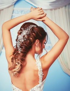 Long lush wedding hairstyle with curls and decoration #hot #sexy #hairstyles #hairstyle #hair #long #short #buns #updo #braids #bang #blond #wedding #style #haircut #bridal #curly #bride #celebrity #black #white #trend #bob #girl #pantyhose #stockings #bikini #legs