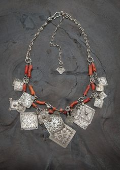Angela Lovett Designs     A modern interpretation of traditional Moroccan coral and silver jewelry, this necklace features antique silver Berber pendants and large antique Saharan coral beads with sterling silver chain.