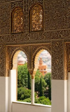 "A view of the Alhambra Palace, in Granada, Andalusia. The calligraphy reads ""و لا غالب إلا الله"" - ""There is no victor besides Allah"". The Alhambra was completed by the last Muslim state of Spain, Granada in the — at La Alhambra. Islamic Architecture, Amazing Architecture, Art And Architecture, Architecture Details, Granada Andalucia, Andalusia Spain, Cadiz, Spain And Portugal, Islamic Art"