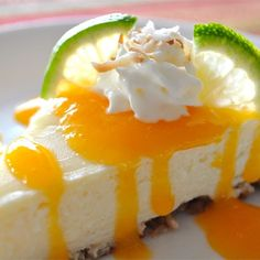 "Coconut-Lime Cheesecake with Mango Coulis I ""This is absolutely delicious! We loved it. Each flavor stands on it's own, none of which are overpowering. The combination of flavors, the smooth texture, the sweet/tart mix, everything is perfect. Husband said 'it tastes like summer!'"""