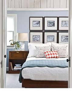 Love the pictures in lieu of a headboard, plus the contrasting throw pillow