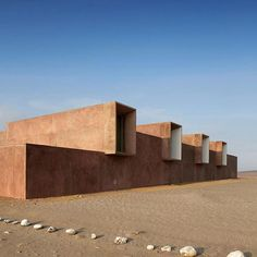 Red pigmented concrete forms the new archaeology museum in Paracas, Peru.  Completed in 2012, the museum was designed by Barclay & Crousse to replace another destroyed during an earthquake in 2007. ⠀ .⠀ Photo is copyright Cristóbal Palma⠀ .⠀ #concrete #art #arch #architecture #design #sculpture #desert #red #peru #paracas