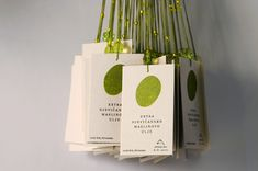 Olive oil  Packaging, tag  Olive is presented as individual fingertip (hand, finger mark) of family which cares for trees, picks olives and creates top-quality extra vergine olive oil in small amount. Co-author: A. Kovac. - Client: private - 2004