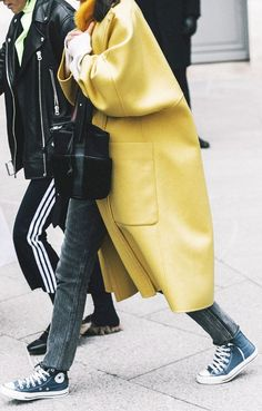 pop of color, yellow coat, colorful coats, cute fall outfit ideas, chuck taylors, track pants, gucci loafers