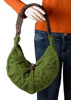 The front and back of our crescent shaped bag are each comprised of four segments of a hexagon, knit from the outside in. A simple cable pattern repeated four times combines to resemble a lotus flower; free pattern