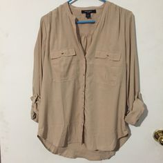 Nine West silky button down tunic Light mocha colored tunic/blouse in a silky polyester. Beautiful with leggings or could be worn tucked in. Button down style with gold buttons and breast pocket on each side. Nine West Tops Blouses