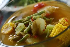 Sayur Asem~ (Sour Dish/Tamarind Dish) clear soup with assorted vegetables such as: (melinjo) or gnetum gnemon, melinjo leaves, sweet corn (still on the cobs), young papaya, peanuts, and tamarind.